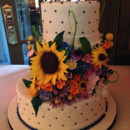 Hand sculpted sugar flowers, fondant quilting and an off-set tier make this a unique and playful Summer wedding cake.