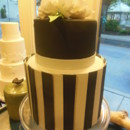 A modern black and white wedding cake with a unique and striking aesthetic.