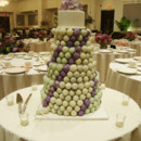 A cake pop tower, with a fondant cake as the top tier, topped with hand sculpted sugar hydrangea.