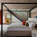 130x130 sq 1360353848037 loftsuitebedroom
