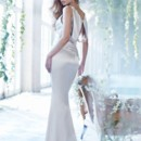 Style AV9367  <br /> Ivory charmeuse bridal sheath with a beaded illusion V neckline at front and back and jeweled appliques at back shoulder.