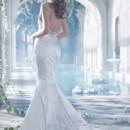 Style AV9410 2  Ivory over oyster silk faced satin bridal gown. Deep V neckline with draped, natural waist bodice, sheer jeweled cap sleeve and low back.
