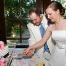 Cutting the cake, with happy anticipation. Photo by Magical Moments Photography.