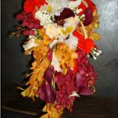 Its a casket Bouquet the colors is burgundy,orange,red,and ivory. The flowers we use are tropical