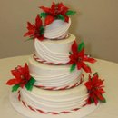 Vanilla Cake, White Buttercream Icing, Hand made Poinsettias and Fondant Drape for 250 Guests