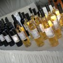 130x130 sq 1291851994687 winebottles
