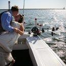 130x130 sq 1315413029376 lakemichiganbeachwaterboatweddingphoto