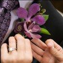 130x130 sq 1226680182336 orchidboutonniere