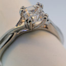 twist on the traditional solitaire diamond engagement ring. antique style split prongs hold in the center diamond. As pictured one GIA D VS2 1.02ct assher cut. $16,000.00 We can make this style with any shape or size center stone, including colors, in any color gold or platinum .
