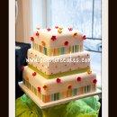 130x130_sq_1296609778967-3tierstrippedribbonflowersdotsweddingcake