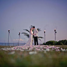 220x220 sq 1525159482 27ce3029a35c8a8a 1448919699448 pic 04 heather and james kissing at end of aisle