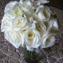 130x130_sq_1289475786952-rainflowercompanyrosesminicallaliliesstefanotiswithcrystalsbouquetkatie