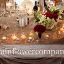 130x130 sq 1295489884448 rainflowercompanyheadtableflowers