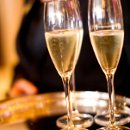 130x130 sq 1344276638919 champagneglasses