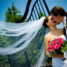 220x220 sq 1457633927755 kiss with veil and flowers