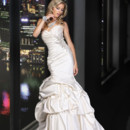 90164  This fit and flare silhouette features a full pick up skirt, with an allover pleated bodice, enhanced with a hand beaded motif