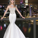 90165  This fit and flare gown features an exquisite hand beaded bodice with luxuriously draped elegant train.