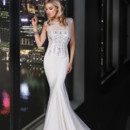 90168  <br /> This delicate scoop illusion neckline of this romantic sheath gown with hand beaded motifs dance throughout the bodice and sexy sheer illusion back.