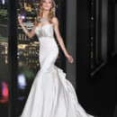 90163  <br /> GORGEOUS BEADING FEATURING SWAROVSKI CRYSTALS THROUGHOUT THE BUST ADORNS THIS GLAMOROUS FIT AND FLARE GOWN HIGHLIGHTED WITH ARTFULLY DRAPING BACK TREATMENT