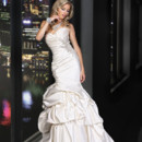 90164  THIS FIT AND FLARE SILHOUETTE FEATURES A FULL PICK UP SKIRT WITH AN ALL OVER PLEATED BODICE ENHANCED WITH HAND BEADED MOTIF