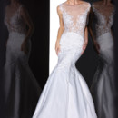 90201  <br /> THIS ROMANTIC FIT AND FLARE GOWN DECORATES WITH DELICATE LACE REVEALING A HINT OF SKIN, FINISHED WITH AN ILLUSION BATEAU NECKLINE AND KEY HOLE BACK