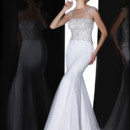 90206  THIS ELEGANT FIT AND FLARE FEATURING AN ILLUSION BATEAU NECKLINE EMBELLISHED WITH CRYSTALS ON SHOULDER AND THROUGHOUT THE BODICE WITH OPEN ILLUSION BACK