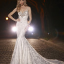 Style 90257  A glamorous soft sheath gown, with lavish beaded embellishements along the neckline and shoulder straps, complete with a beaded low back