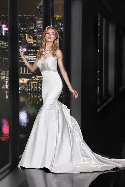 90163	<br>	GORGEOUS BEADING FEATURING SWAROVSKI CRYSTALS THROUGHOUT THE BUST ADORNS THIS GLAMOROUS FIT AND FLARE GOWN HIGHLIGHTED WITH ARTFULLY DRAPING BACK TREATMENT