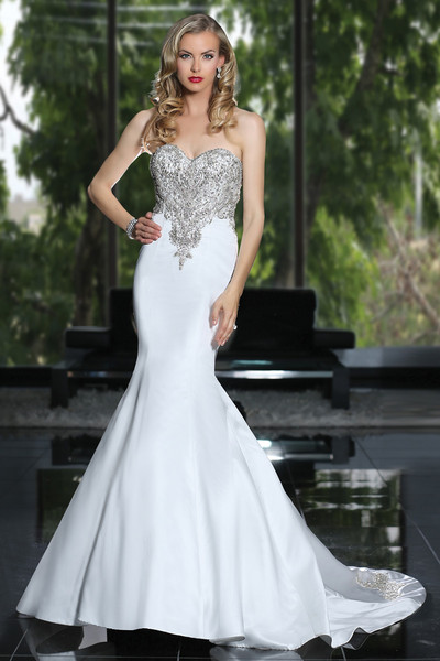 Simone Carvalli Style 90211  A classic silhouette with dramatic flare, dazzling beading lays on a sweetheart neckline bodice, finished with a sexy low back.