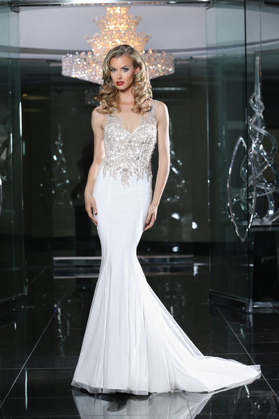 Simone CarvalliStyle90213<br>This vintage glamour gown, is embellished with intricate beading with an illusion neckline, floating into a dramatic low back.