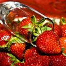 130x130 sq 1221056437915 strawberriesinchampagneglass