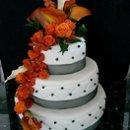 130x130_sq_1236624257626-orange-drapped-flowers_l