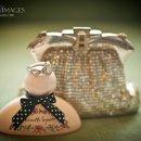 130x130 sq 1327993271241 engagementringvintagepurseperfume1