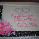 130x130_sq_1222546842917-blackribboncake
