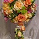 130x130 sq 1345156776978 bouquet042307cascaderosedemdrobiumorangeyellowcoral1005972