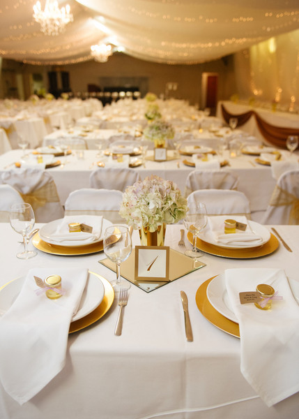 Banquet Tables Were Dressed Up With Crisp White Linens And Elegant Gold Charger Plates Chandeliers