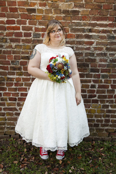 The Bride Looked Great In A Lace Tea Length Dress Featuring An Illusion Neckline