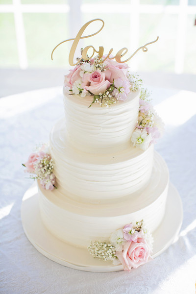 The Classic Buttercream Cake Was Decorated With Spray Roses Stock Babys Breath And