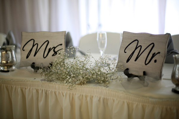 The Head Table Was Decorated With Cute Mrs And Mr Signs Reception Venue