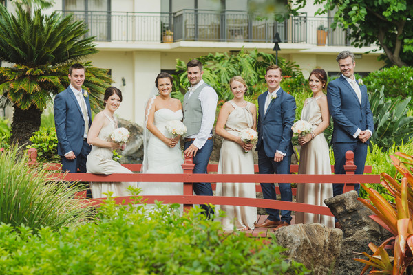 The Bridesmaids Wore Shimmering Champagne Colored Gowns While Groomsmen Were Dressed In Navy