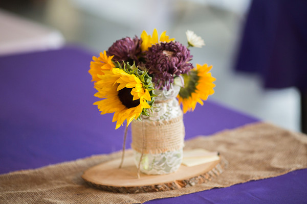 Rustic purple yellow barn centerpiece kansas spring sunflower reception tables were decorated with burlap runners and mason jar centerpieces venue schwinn produce mightylinksfo