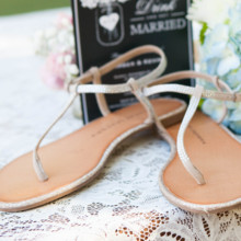 "<strong class='info-row'>lisa d. Photography</strong> <div class='info-row description'><html>  <head></head>  <body>    Amber wore sandal flats with silver straps.   Venue:   <a href=""https://www.weddingwire.com/reviews/whispering-tree-ranch/538664c81ed617fd.html"" target=""_blank""> Whispering Tree Ranch </a>      </body> </html></div>"