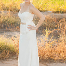 "<strong class='info-row'>lisa d. Photography</strong> <div class='info-row description'><html>  <head></head>  <body>    She donned a gorgeous sheath lace gown accessorized with a sweetheart neckline and   Venue:   <a href=""https://www.weddingwire.com/reviews/whispering-tree-ranch/538664c81ed617fd.html"" target=""_blank""> Whispering Tree Ranch </a>  Bride's Gown:   <a href=""https://www.weddingwire.com/biz/almond-tree-wedding-boutique-phoenix/c9eac35b2f115757.html"" target=""_blank""> Almond Tree</a>      </body> </html></div>"