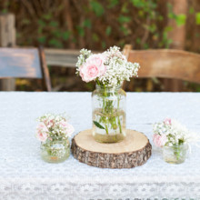 "<strong class='info-row'>lisa d. Photography</strong> <div class='info-row description'><html>  <head></head>  <body>    Reception tables were decorated with lace linens and centerpieces that included wooden tree slices and mason jars filled with baby's breath and roses.   Venue:   <a href=""https://www.weddingwire.com/reviews/whispering-tree-ranch/538664c81ed617fd.html"" target=""_blank""> Whispering Tree Ranch </a>       <div>         </div>   </body> </html></div>"