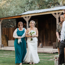 "<strong class='info-row'>lisa d. Photography</strong> <div class='info-row description'><html>  <head></head>  <body>    Amber had her mother walk her down the aisle during the processional!   Venue:   <a href=""https://www.weddingwire.com/reviews/whispering-tree-ranch/538664c81ed617fd.html"" target=""_blank""> Whispering Tree Ranch </a>      </body> </html></div>"