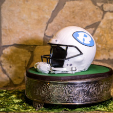 "<strong class='info-row'>Svetlana Photography</strong> <div class='info-row description'><html>  <head></head>  <body>    An edible football helmet served as the groom's cake.   Venue:    <a href=""https://www.weddingwire.com/biz/the-vista-on-seward-hill-austin/8620a87097a99c38.html"" target=""_blank"">The Vista on Seward Hill</a>  Cake:    <a href=""https://www.weddingwire.com/biz/simon-lee-bakery-pflugerville/e28b94b9588e074b.html"" target=""_blank"">Simon Lee Bakery</a>   </body> </html></div>"