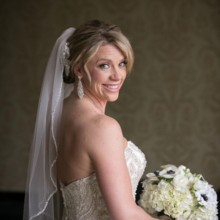 """<strong class='info-row'>Pond Photography</strong> <div class='info-row description'><html>  <head></head>  <body>    The bride's hair was styled into a romantic updo and she wore an elbow-length veil.     <span class=""""s1"""">Event Planner: <a href=""""https://www.weddingwire.com/biz/madison-sanders-events-liberty/bfd7956686c7ed3d.html""""><span class=""""s2"""">Madison Sanders Events</span></a></span>  Bridal Gown:    <a href=""""https://www.weddingwire.com/biz/bridal-extraordinaire-shawnee/c84c47ee18d66085.html""""><span class=""""s2"""">Bridal Extraordinaire</span></a>  Flowers:    <a href=""""https://www.weddingwire.com/biz/good-earth-floral-design-studio-overland-park/f0497b6bc386f384.html""""><span class=""""s2"""">Good Earth Floral Design Studio</span></a>   </body> </html></div>"""