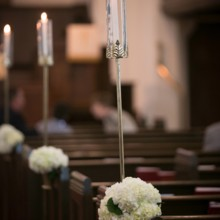 """<strong class='info-row'>Pond Photography</strong> <div class='info-row description'><html>  <head></head>  <body>    The aisles at the church were marked with white hydrangea arrangements and candles in tall glass holders.     <span class=""""s1"""">Ceremony Venue: Country Club United Methodist Church</span>     <span class=""""s1"""">Event Planner: <a href=""""https://www.weddingwire.com/biz/madison-sanders-events-liberty/bfd7956686c7ed3d.html""""><span class=""""s2"""">Madison Sanders Events</span></a></span>  Flowers:    <a href=""""https://www.weddingwire.com/biz/good-earth-floral-design-studio-overland-park/f0497b6bc386f384.html""""><span class=""""s2"""">Good Earth Floral Design Studio</span></a>   </body> </html></div>"""