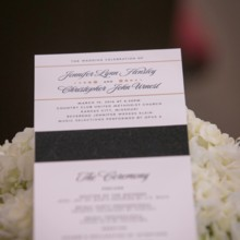 """<strong class='info-row'>Pond Photography</strong> <div class='info-row description'><html>  <head></head>  <body>    The ceremony programs were black, gold, and white to match the wedding day color scheme.     <span class=""""s1"""">Event Planner: <a href=""""https://www.weddingwire.com/biz/madison-sanders-events-liberty/bfd7956686c7ed3d.html""""><span class=""""s2"""">Madison Sanders Events</span></a></span>  Stationery:    <a href=""""https://www.weddingwire.com/biz/yellowbrick-graphics-overland-park/09f2c5223d83a2bc.html""""><span class=""""s2"""">YellowBrick Graphics</span></a>   </body> </html></div>"""