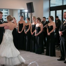 """<strong class='info-row'>Pond Photography</strong> <div class='info-row description'><html>  <head></head>  <body>    The couple danced to """"I Won't Give Up"""" by Jason Mraz for their first dance as the wedding party looked on.     <span class=""""s1"""">Reception Venue: <a href=""""https://www.weddingwire.com/biz/the-brass-on-baltimore-kansas-city/38e651de12a08110.html""""><span class=""""s2"""">Brass on Baltimore</span></a></span>     <span class=""""s1"""">Event Planner: <a href=""""https://www.weddingwire.com/biz/madison-sanders-events-liberty/bfd7956686c7ed3d.html""""><span class=""""s2"""">Madison Sanders Events</span></a></span>  Reception Music:    <a href=""""https://www.weddingwire.com/reviews/patrick-lentz-band-kansas-city/8144fa54ad356e0b.html""""><span class=""""s2"""">Patrick Lentz Band</span></a>  Lighting:    <a href=""""https://www.weddingwire.com/reviews/ultrapom-event-rental-kansas-city/f8f3af69df5fc419.html""""><span class=""""s2"""">Ultrapom Event Rentals</span></a>   </body> </html></div>"""